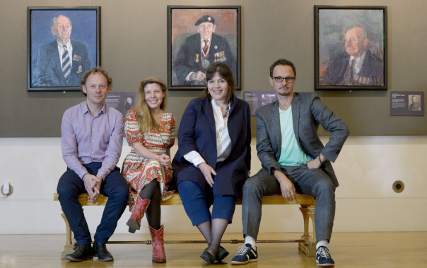 "Guardian: ""L to R: Artists James Lloyd, Clara Drummond, Catherine Goodman and Jonathan Yeo pose in front of portraits of Sgt Thomas Burke by Lloyd, trooper Cecil Newton by Peter Kuhfield and pilot Laurence Weeden by Martin Yeoman. Photograph: Anthony Devlin/PA"""