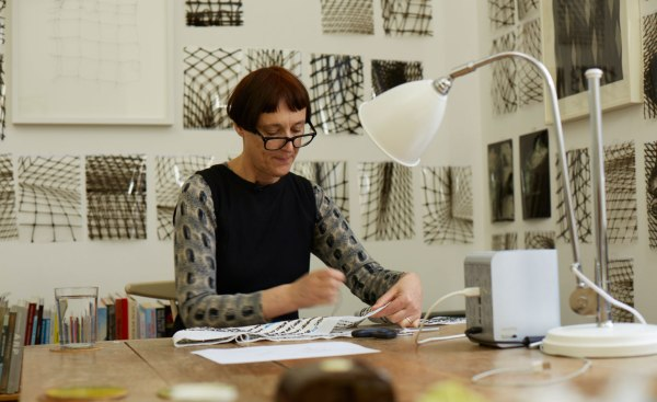 Wallpaper: Cornelia Parker's Magna Carta (An Embroidery) is an intricate textile work recreating the entire Wikipedia entry on the eponymous English dictum. Pictured: Parker at work on the piece. Photography: Joseph Turp
